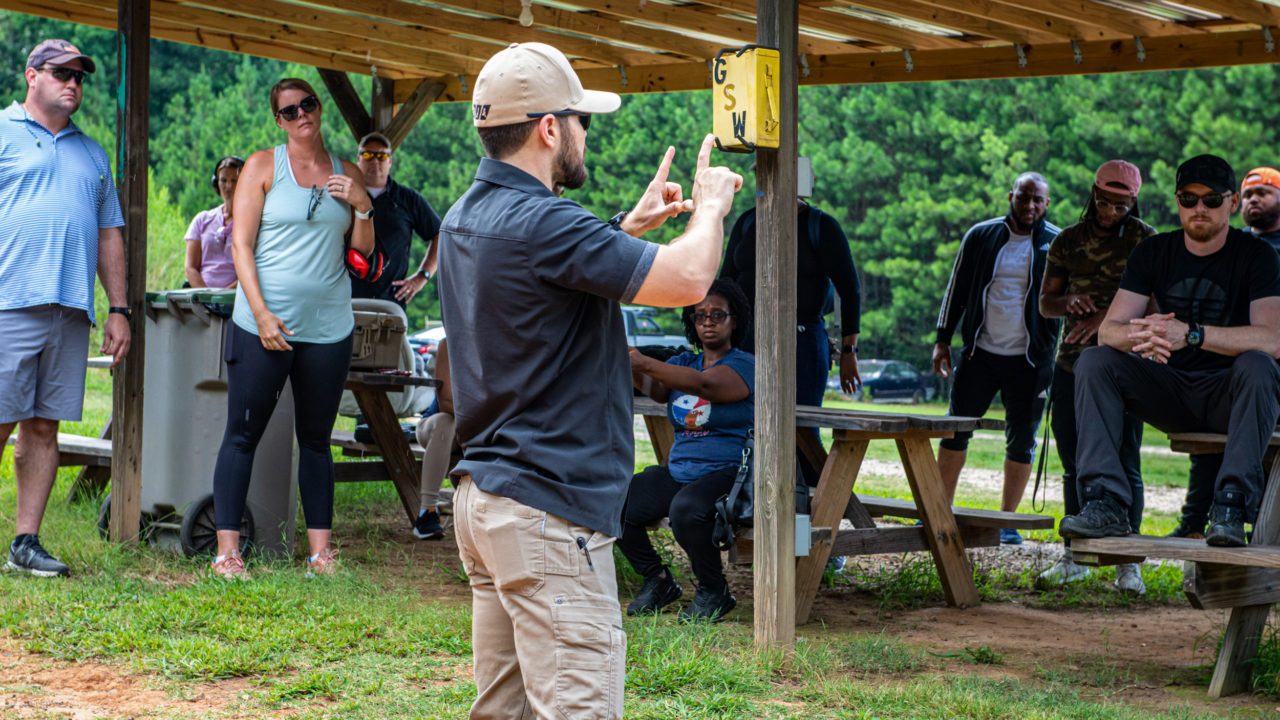 Teaching concealed carry students how to align the sights on a gun
