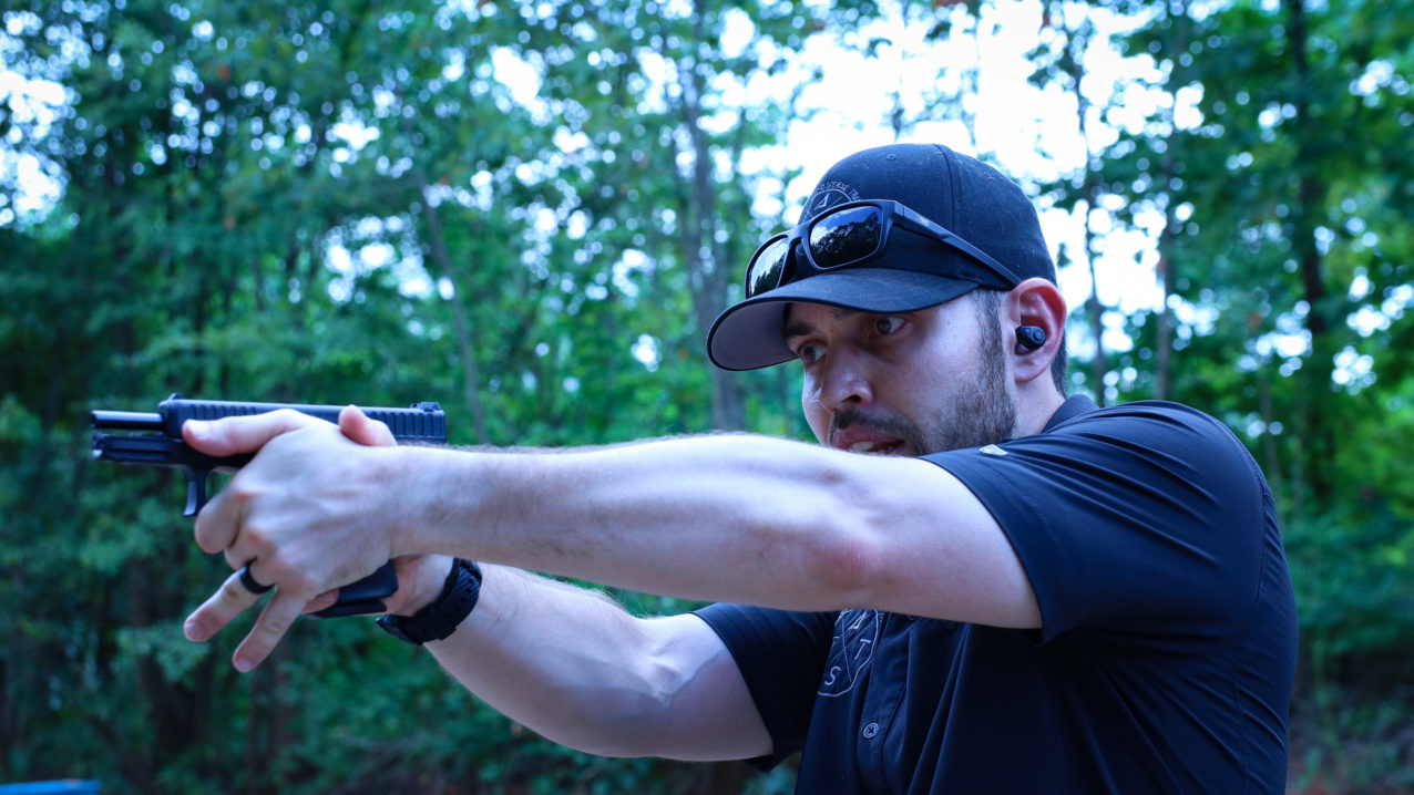 Instructor Stewart teaches proper grip and shooting fundamentals during a concealed carry class in durham, north carolina